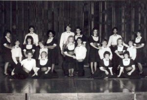 1984-1985 Montage - black and white photograph of a 21-person choir
