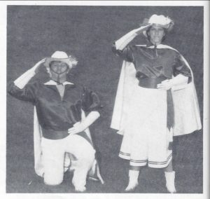 Tracy and Tom posing in their drum major uniforms.