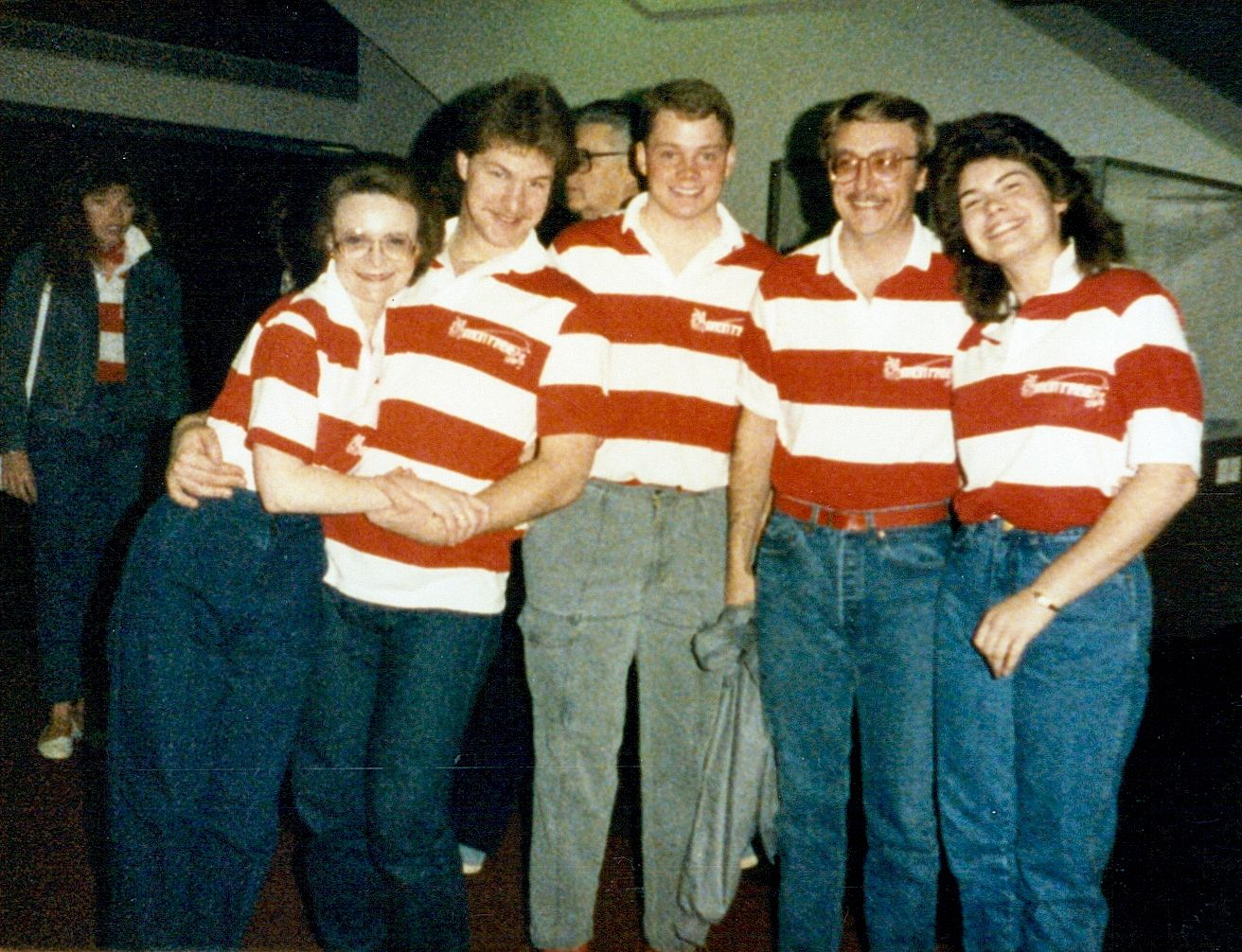 Group of five people in striped shirts.